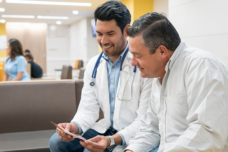 Latino doctor with patient